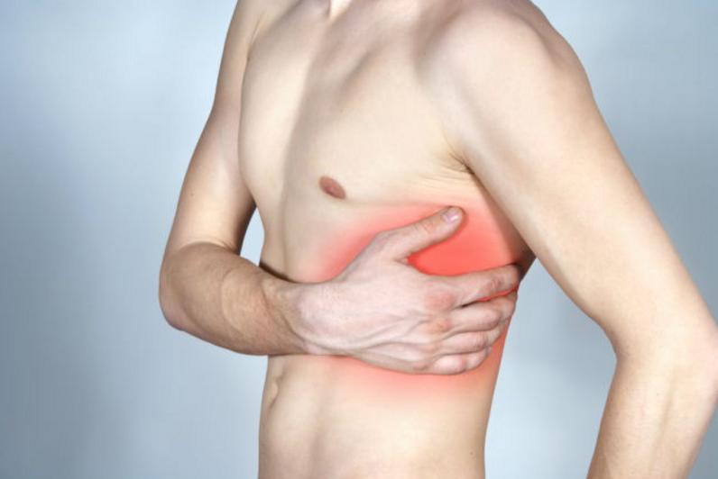 Что может болеть в правом подреберье со спины
