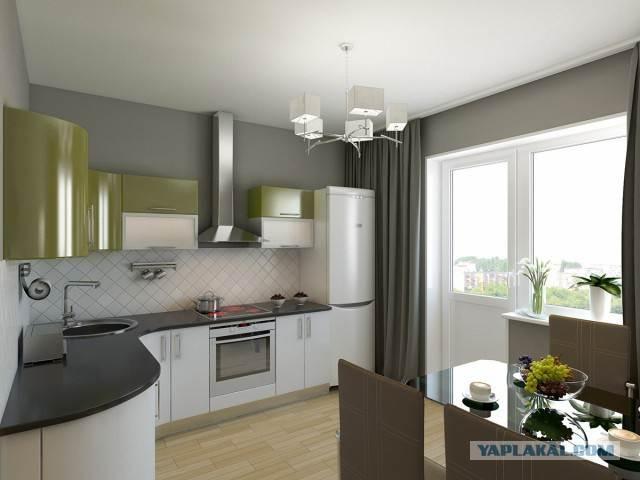 Угловая бело-зеленая кухня с просторной обеденной зоной