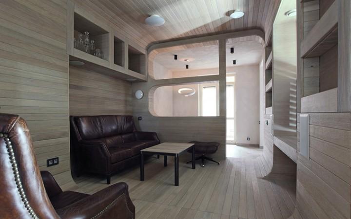 <p>Автор проекта: Петр Костелов.</p> <p>Дополнительное пространство в этом интерьере получилось не только благодаря балккону, присоединеному к комнатам, но и нишам в стенах. В одну из них, самую большую, поместился даже объемный кожаный диван. </p>