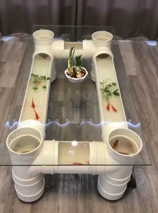 Журнальный стол с живыми рыбками. | Фото: Pinterest.