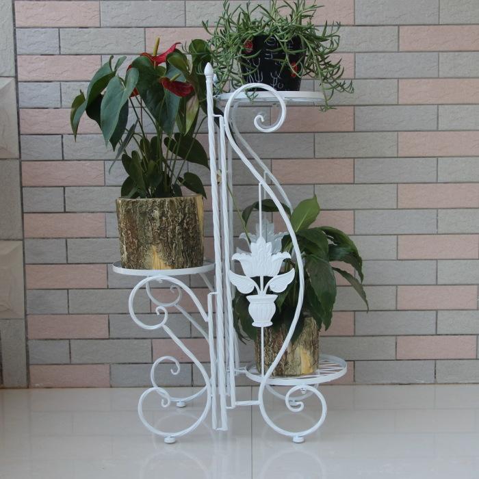 Кованая напольная подставка для цветов