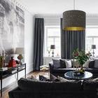 Изысканная современная квартира с черным шкафом в Стокгольме