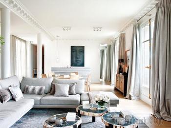 Современная изысканность с винтажной мебелью в дизайне квартиры в Париже