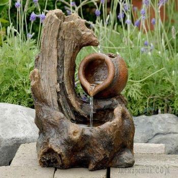 18 невероятных фонтанов из дерева, которые обязательно нужно поставить на даче