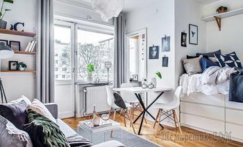 Скандинавская квартирка 22 м² с необычной кроватью