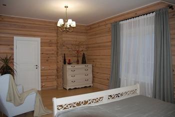 Спальня: природные оттенки, натуральные материалы в изысканном интерьере