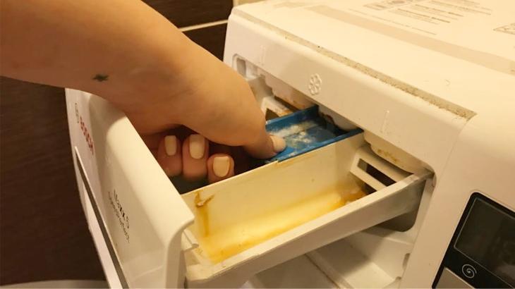 Как вытащить лоток для стирального порошка